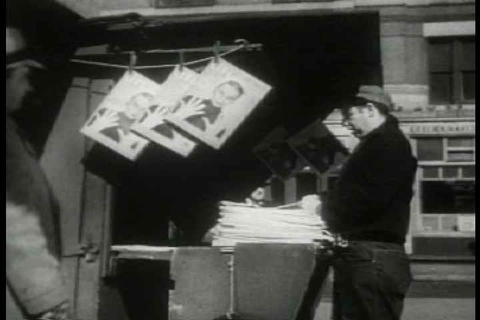 Archival film depicting blank newspapers being del Footage