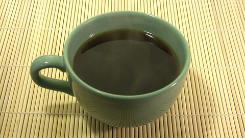 Big cup of steaming hot coffee Stock Video Footage