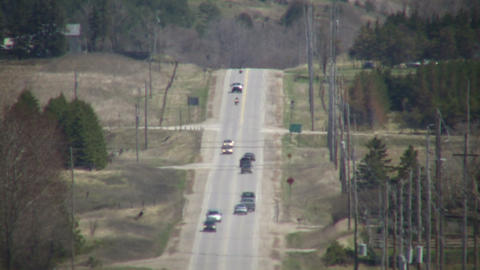 Cars are driving down a country road (High Definition) Stock Video Footage