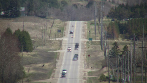 Cars are driving down a country road (High Definition) Footage