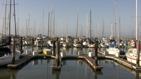 Boats and yachts are gently floating in the docks Stock Video Footage