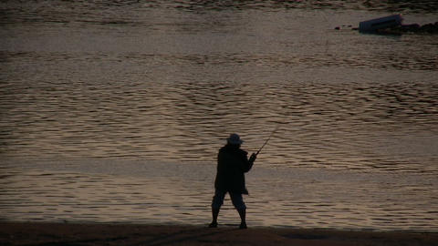 Man is fishing in the Sacramento River at sunset Stock Video Footage