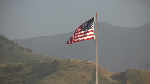 American flag stands tall among the San Francisco hills Stock Video Footage