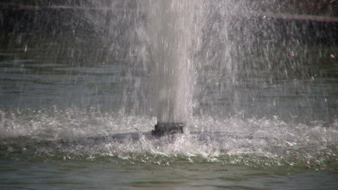 Closeup as water sprays up from fountain Stock Video Footage