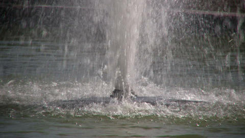 Closeup as water sprays up from fountain Footage