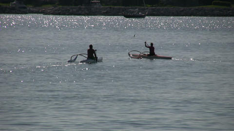 Couple are kayaking on a beautiful sparkling lake (High... Stock Video Footage
