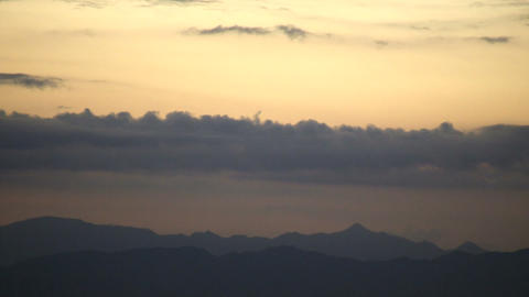 Mountain scenic with clouds drifting overhead at dawn... Stock Video Footage
