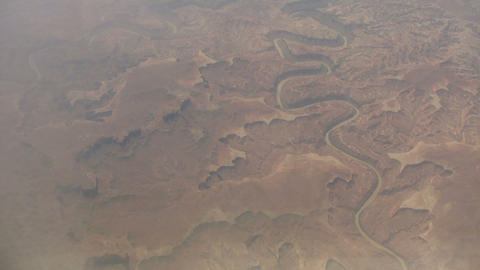 Aerial shot of a river cutting through the rocky landscape Live Action