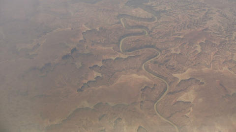 Aerial shot of a river cutting through the rocky landscape Stock Video Footage