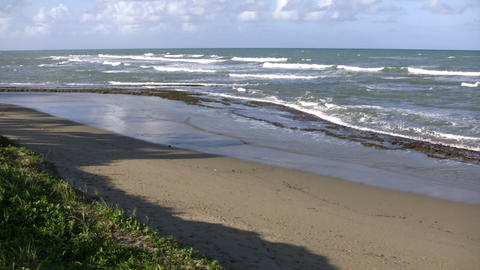 Waves gently wash up onto beach, then recede (High... Stock Video Footage
