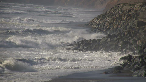 Ocean waves crash against the rocky San Francisco shore Footage