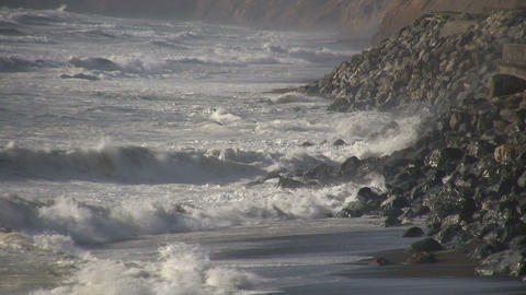 Ocean waves crash against the rocky San Francisco shore Stock Video Footage