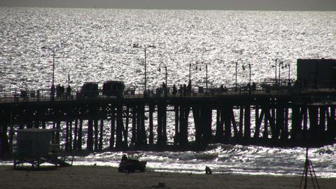 People walking on boardwalk of Santa Monica pier (High... Stock Video Footage