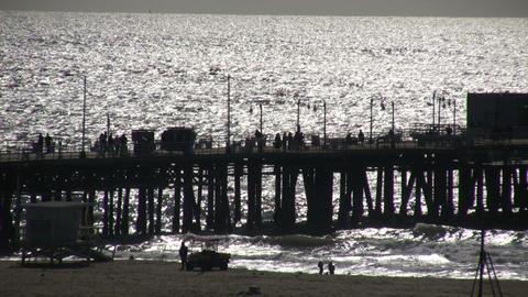 People walking on boardwalk of Santa Monica pier (High... Stock Video Footage