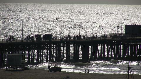 People walking on boardwalk of Santa Monica pier (High Definition) Footage