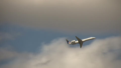 Commercial jet ascends through the cloudy blue sky Stock Video Footage