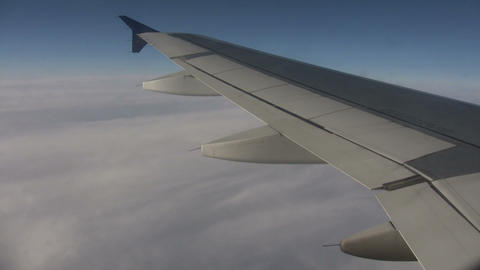 Airplane wing sways in wind on sunny day (High Definition) Stock Video Footage