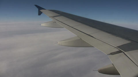 Airplane wing sways in wind on sunny day (High Definition) Footage