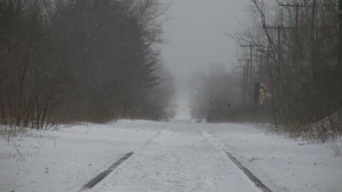 Winter scenic of snow blowing over train tracks (High Definition) Footage
