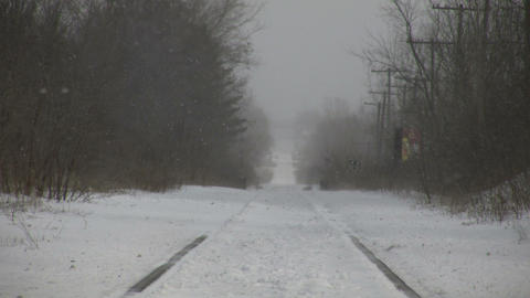Winter scenic of snow blowing over train tracks (High... Stock Video Footage