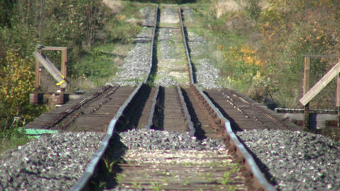 Railway tracks head off into the sunny distance (High Definition) Footage