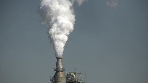 Closeup of fumes spilling out of a large chimney Footage