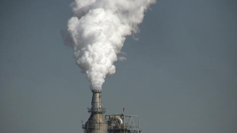 Closeup of fumes spilling out of a large chimney Stock Video Footage