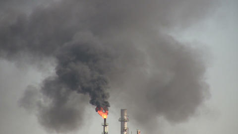Closeup of black fumes from burning chimney at Houston Refinery Footage