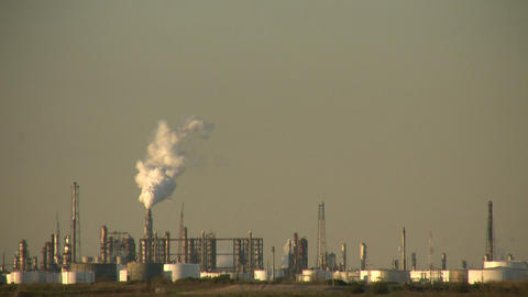 Fumes billow out of large chimney at Houston BP Refinery Stock Video Footage