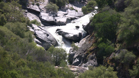Kaweah River flows downstream through the rocks, creating whitewater rapids Footage