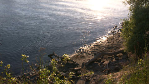 Sunset reflects off surface of the Sacramento River Stock Video Footage