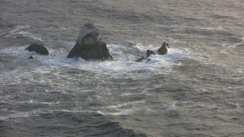 Ocean waves crash against the rocky outcrops Stock Video Footage