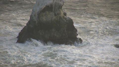 Ocean waves crash against the rocky outcrops Footage