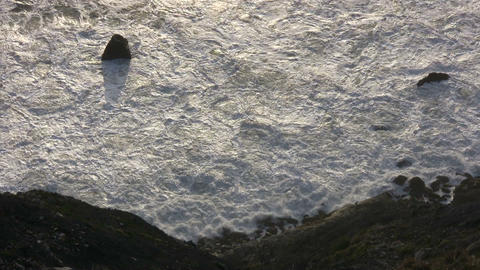 Rough ocean waves crash against the rocky San Francisco shoreline Live Action