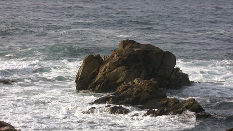 Ocean waves crash against the Californian rocky outcrops Stock Video Footage