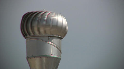 Root ventilator spins in the sunlight (High Definition) Stock Video Footage