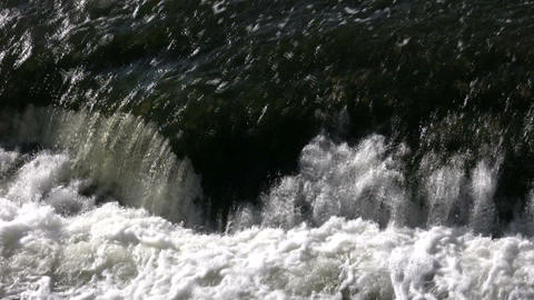 Closeup of foamy and turbulent water from waterfall (High Definition) Footage