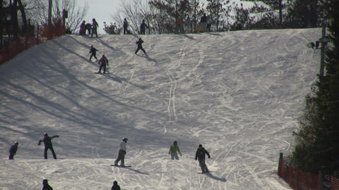 Winter scenic of people skiing down a hill (High Definition) Footage