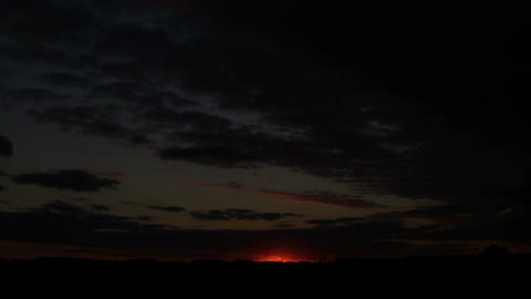 Faint glow from sunset is visible in distance (High... Stock Video Footage