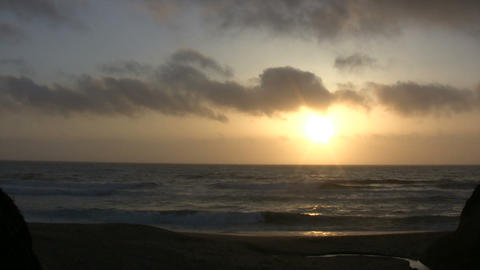Sun is setting over the ocean in this beach scenic Stock Video Footage