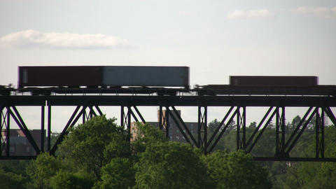 Silhouette of a freight train moving down tracks (High Definition) Footage