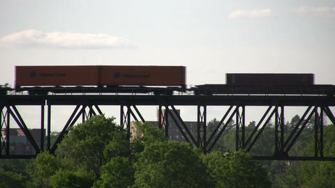 Silhouette of a freight train moving down tracks (High... Stock Video Footage