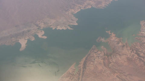 Aerial shot of a body of water amidst rocky landscape Stock Video Footage