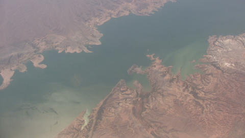 Aerial shot of a body of water amidst rocky landscape Footage