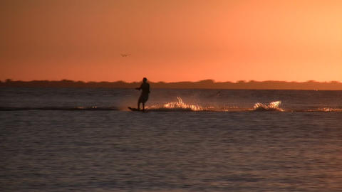 Person is water skiing at sunset (High Definition) Stock Video Footage