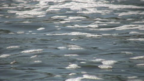 Closeup of water's flowing surface as it ripples (High Definition) Footage