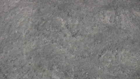 Closeup of the water's foamy and rippling surface (High... Stock Video Footage