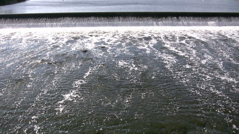 River's surface is turbulent, creating white water rapids... Stock Video Footage