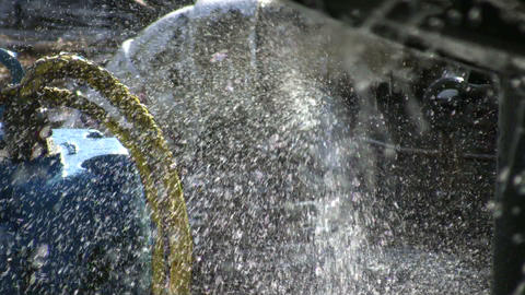 Closeup of water sraying from unseen water wheel (High Definition) Footage
