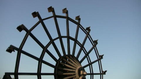 Water wheel slowly turns on a sunny day (High Definition) Stock Video Footage